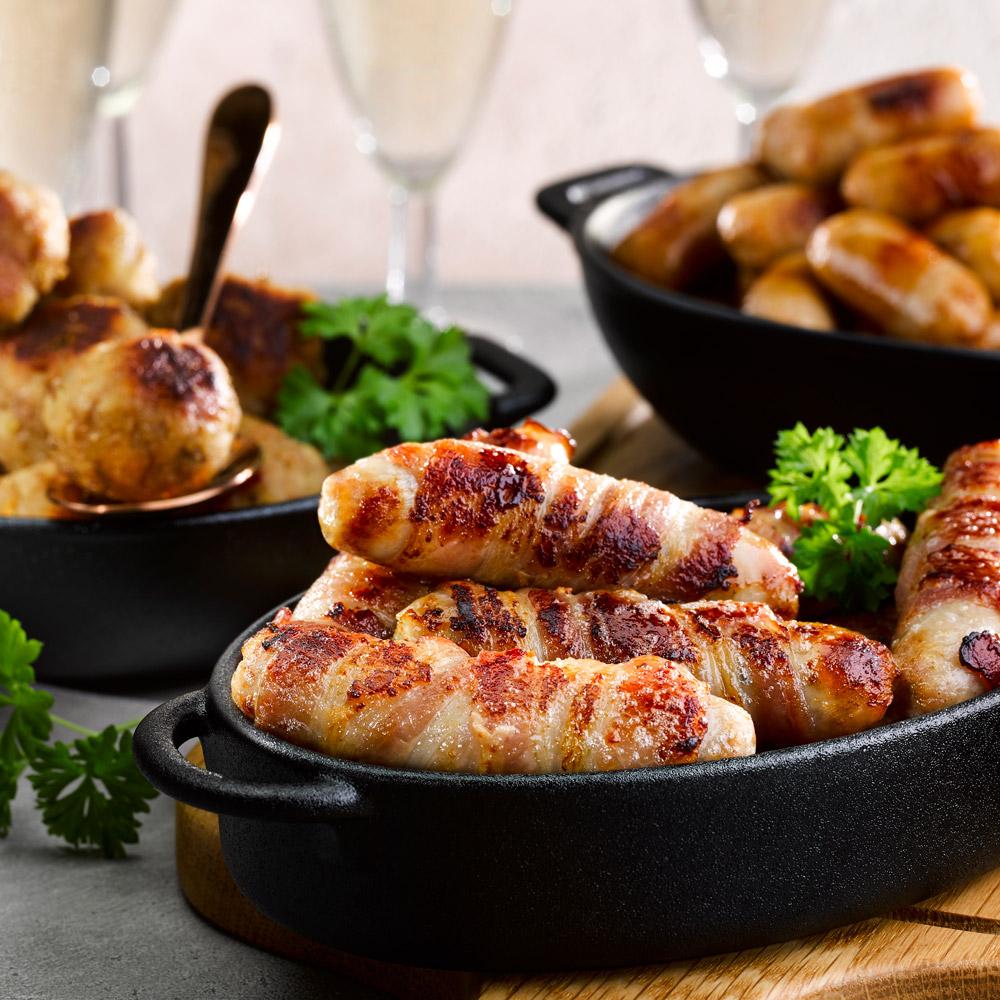 Honey & Rosemary Pork Chipolatas Wrapped In Smoked Bacon
