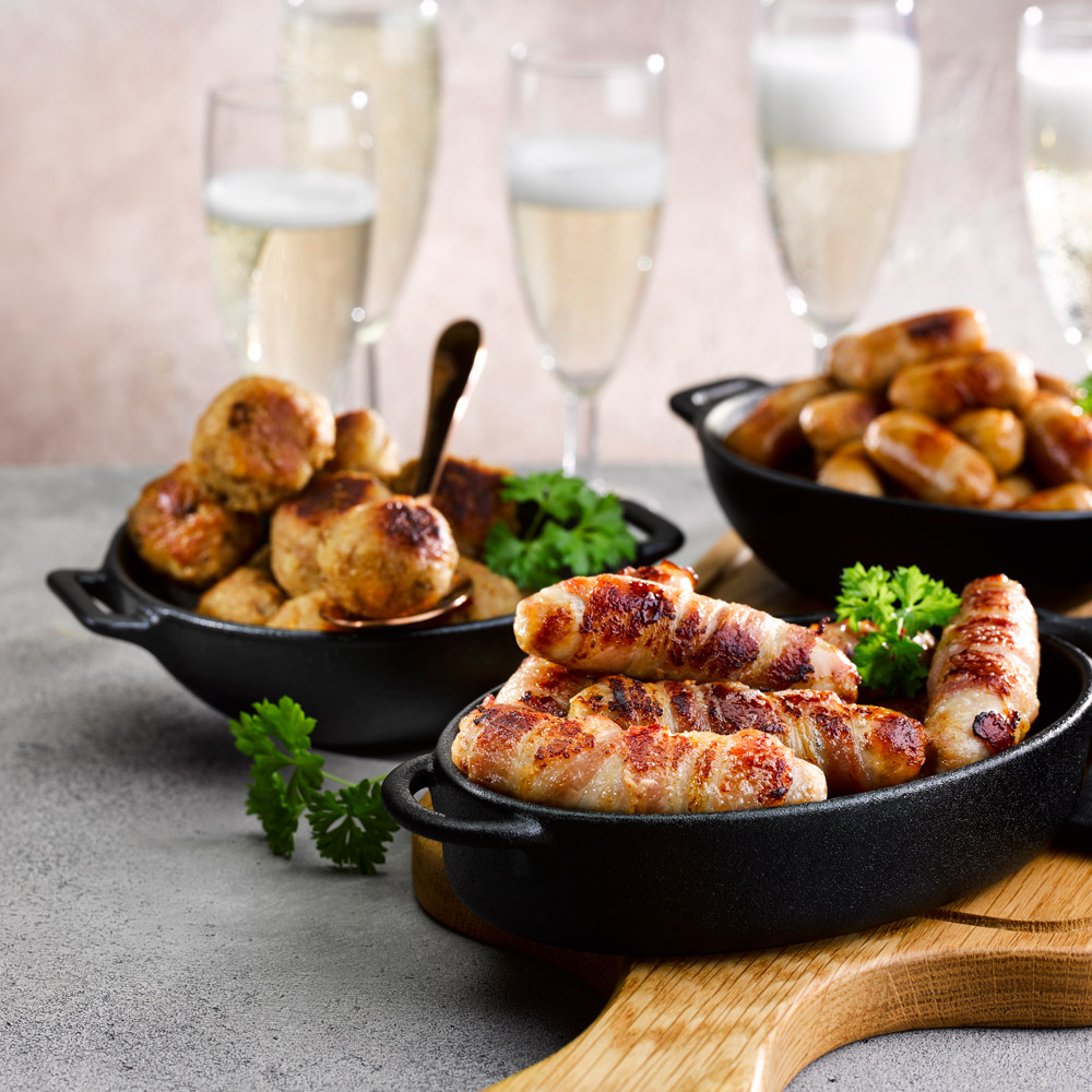 Honey-and-Rosemary-Pork-Chipolatas-Wrapped-In-Smoked-Bacon